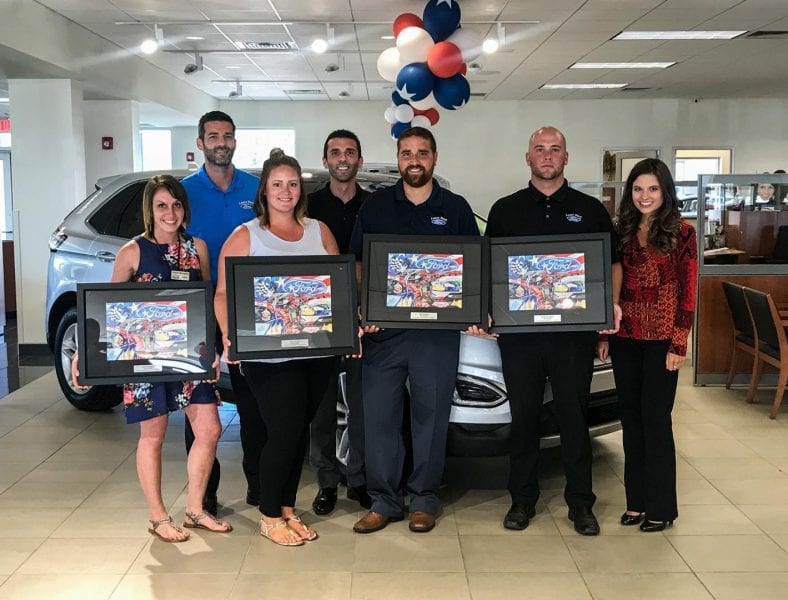 Superior service and customer satisfaction earn four for Ford motor company customer service